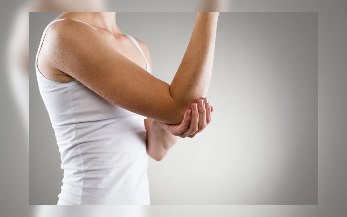 skausmas apatinėje kaulo dešiniojo alkūnės sąnario